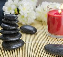 Balance and Homeostasis: Rock balancing, candle, flowers